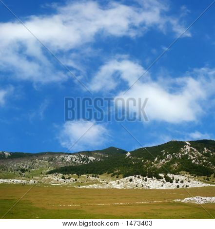 Dinara Mountain Over Blue Sky 11
