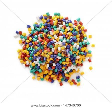 Top view of plastic pellets stack isolated on white