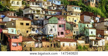Contour shantytown with its colorful houses on the hill by the sea in the city of Salvador in Bahia Brazil