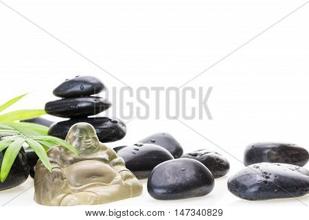 Glass Buddha Miniature, Black Wet Basalt Stones And Green Leaf, On White Background.
