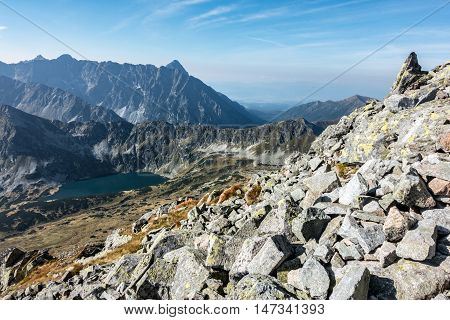 Amazing Summer Rocky Mountains With Lake Under Blue Sky