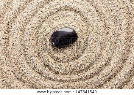 Black Basalt Stone On Sand Imitating Water Ripples