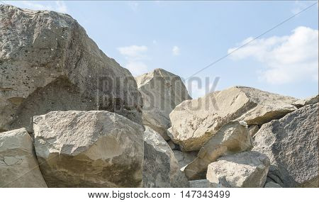 sunny illuminated scenery including a pile of big boulders