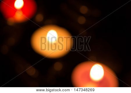 Abstract background with colorful candle lights and bokeh