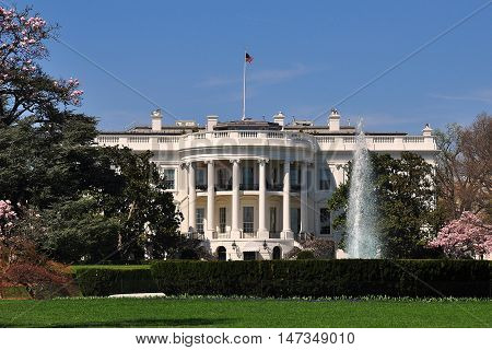 Washington DC - April 10 2014: The south front of the White House with its formal gardens and fountain