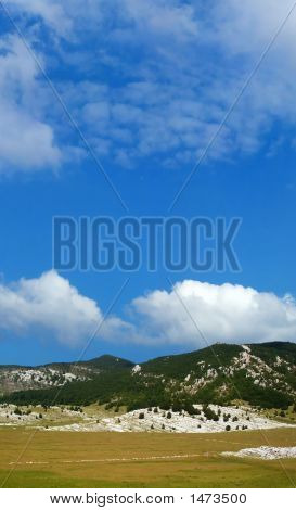 Dinara Mountain Over Blue Sky 15