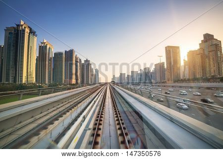 DUBAI, UAE - MARCH 30: Metro line in Dubai on March 30, 2014, UAE. The Dubai Metro is a driverless, fully automated metro rail network in the city of Dubai and carry over 180,000 passengers every day.