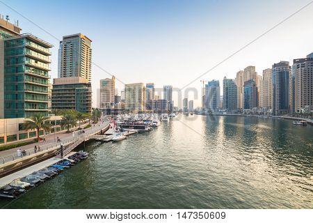 DUBAI, UAE - MARCH 30, 2014: City scenery of Dubai Marina, UAE. Dubai Marina is a district in Dubai with artificial canal skyscrapers who accommodates more than 120,000 people.