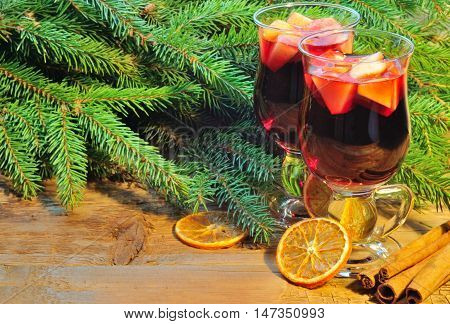Two Glasses Of Mulled Wine, Christmas Tree Branches And Cinnamon