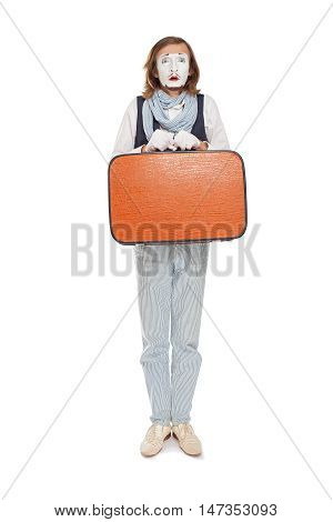 mime actor standing with orange suitcase in anticipation