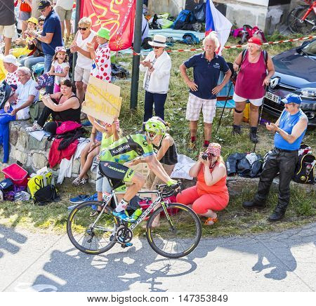 Col du Glandon France - July 23 2015: The LItuanian cyclist Ramunas Navardauskas of Cannondale-Garmin Team riding in a beautiful curve at Col du Glandon in Alps during the stage 18 of Le Tour de France 2015.