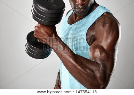 Muscular Man Doing Biceps Curl With Dumbbell