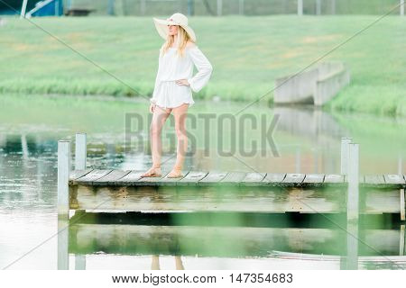 High School Senior Poses For Portraits On Dock