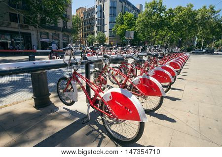 BARCELONA - MAY 21 2016: Row of rental bikes from Vodafone Bicing is a self-service bike-sharing scheme for short journeys.
