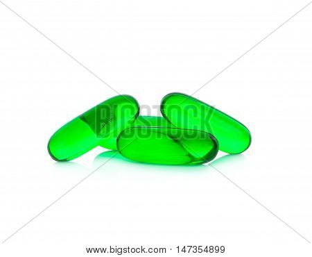 Green pills capsule isolated on white background