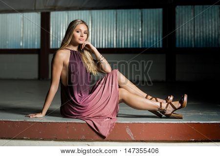 High School Senior Poses For Portraits