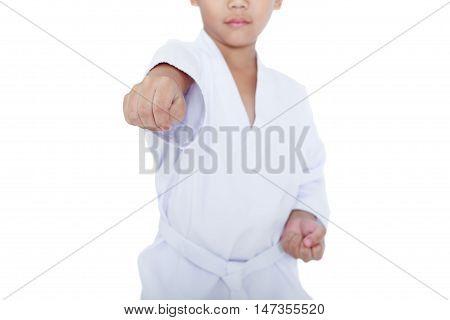 Asian child athletes martial art taekwondo training isolated on white background. Boy with white belt in karate position studio shot.