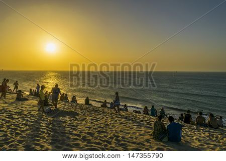 JERICOACOARA, BRAZIL, DECEMBER - 2015 - People at beach in the famous dune of Jericoacoara waiting to see the sunset
