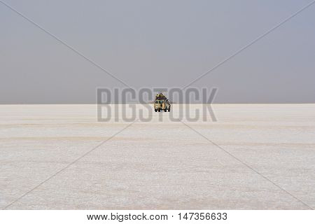 Jeep crossing a salty desert in Ethiopia