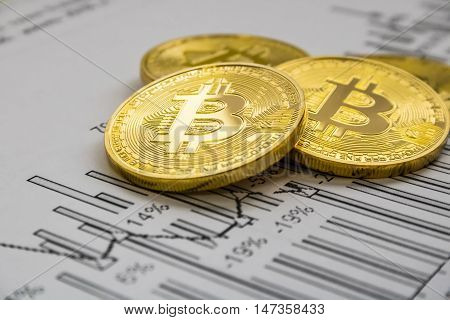A golden bitcoin on graph background. trading concept of crypto currency