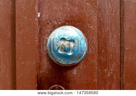 old wood door metal handle close detail