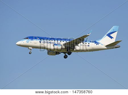 SAINT PETERSBURG, RUSSIA - AUGUST 21, 2015: The Embraer ERJ-170 (ES-AED) company Estonian Air before landing in Pulkovo airport