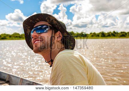 Young man exploring a wetlands in Pantanal, Brazil