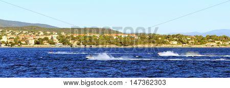Jet skis throwing up spray off the Mediterranean coast