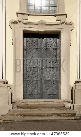 Vintage metal dark grey door decorated with forged ornament background