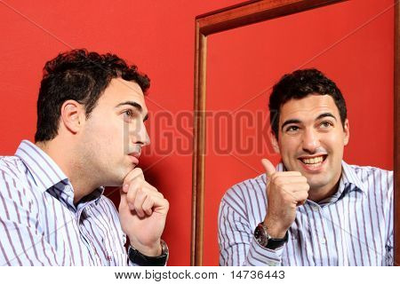 One man, with two faces on the mirror over red background