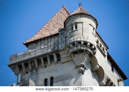 Ancient castle Liechtenstein top of central tower closeup Vienna woods village Maria Enzersdorf Austria - against bright blue sky