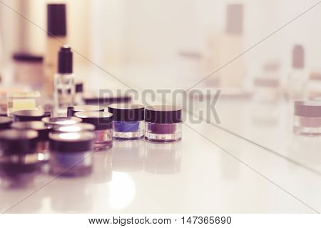 Make Up Tools On The White Table. Eyeshadow, Blush, Concealer, Powder. Vintage Colors
