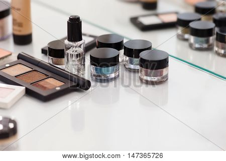 Make Up Tools On The White Table. Eyeshadow, Blush, Concealer, Powder