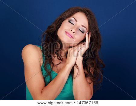 Beautiful Makeup Tired Woman Want To Sleep And She Lying On Her Hands On Blue Background. Closeup