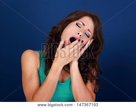 Beautiful Makeup Tired Woman Want To Sleep And Yawning With Manicured Hand Near Mouth On Blue Backgr