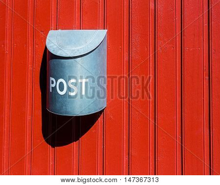 Red wood wall vounted silver post box