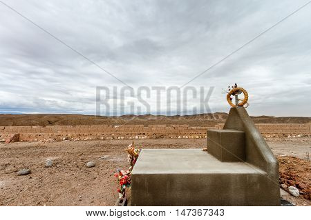 Tomb Decorated With Straw Wreath And Flowers At A Cemetery In Catamarca, Argentina