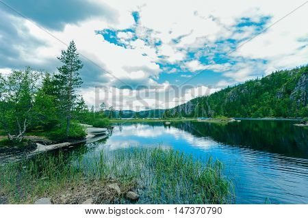 Norway stunning landscape with mountain lake and clouds