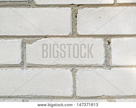 Monotone texture in cold colors of the bricks.