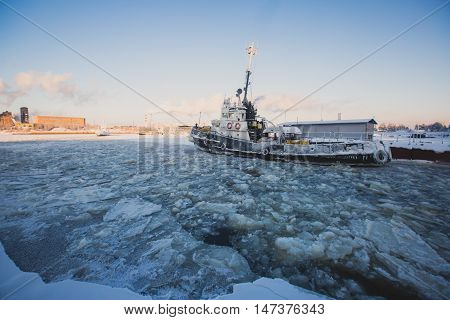 The Icebreaker Ship Trapped In Ice Tries To Break And Leave The Bay Between The Glaciers