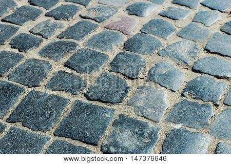 Walkway of old paving stones on the street
