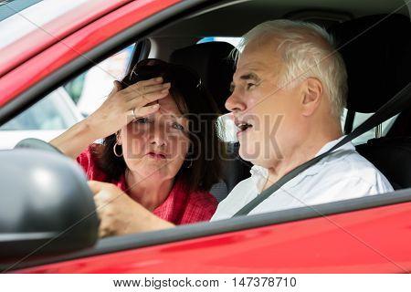 Unhappy Senior Couple Arguing In A Car