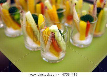 Finger food. Stick vegetable salad in a shot glass
