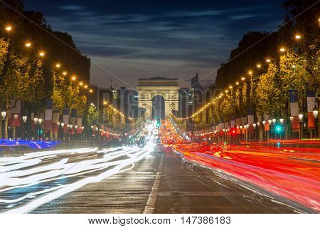 Arc de triomphe Paris city at sunset France. Champs Elysees street at night in Paris France.