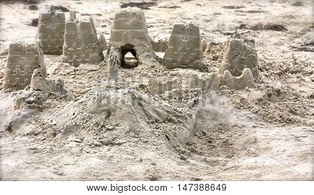 Detailed Photo of a sandcastle work in progress