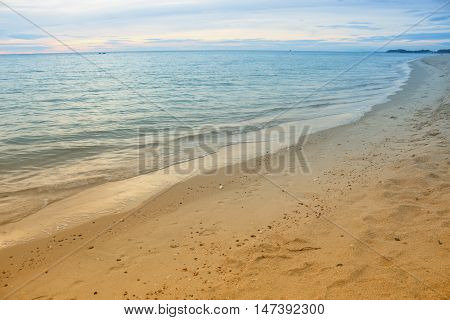 Sea water beach and sky. motion of the sea in the morning. Cold Warm Filter look Colorful. Select focus with shallow depth of field Soft focus noise and grain due long exposure. with copy space.