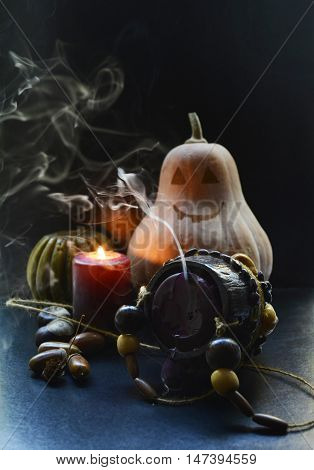 Halloween, pumpkins , candles, acorns and chestnuts , decorations for the holiday Halloween