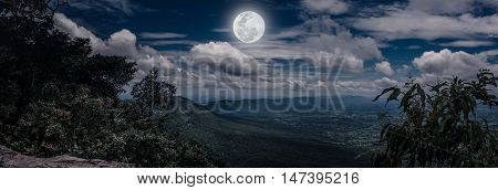 Panorama Of Tree And Boulders Against Nighttime Sky With Cloudy. Outdoor.