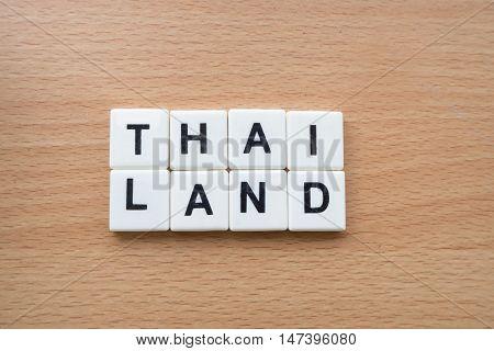 Thailand wording text symbol on wood flooring.