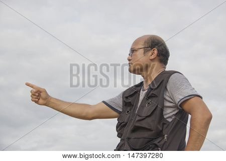 Man pointing commands. businessman hand forefinger pointing something.